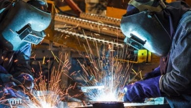 workers using welding gloves