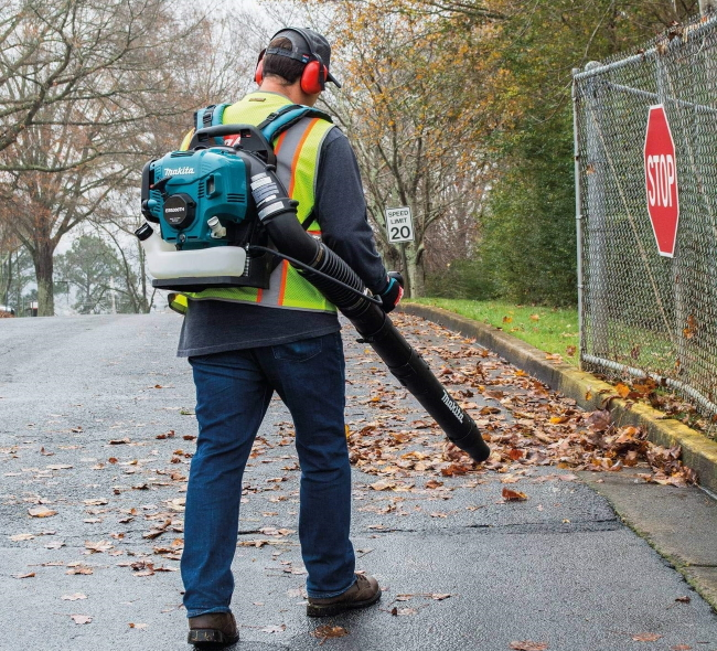 backpack leaf blower on wet pavement